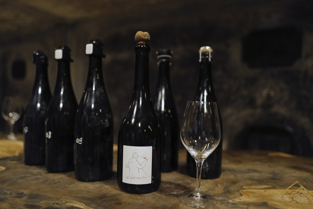 Champagne bottles for tasters are displayed in the cave of Champagne producer Anselme Selosse in Avize, in the Champagne region, east of Paris, Tuesda...