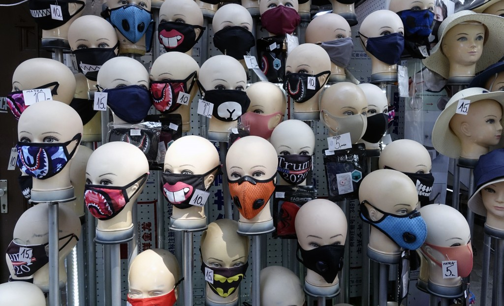Mannequin heads wear face masks in a display outside a shop in Sarajevo, Bosnia's main street on Monday, July 27, 2020. The regional World Health Orga...
