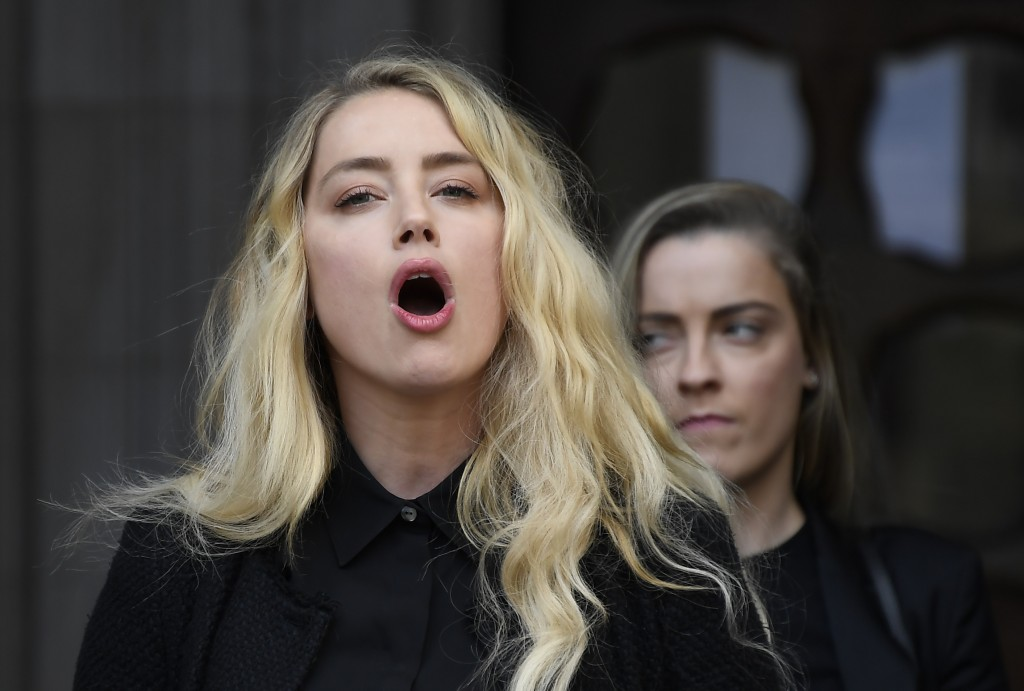 American actress Amber Heard, former wife of actor Johnny Depp, speaks after the end of the trial outside the High Court in London, Tuesday, July 28, ...