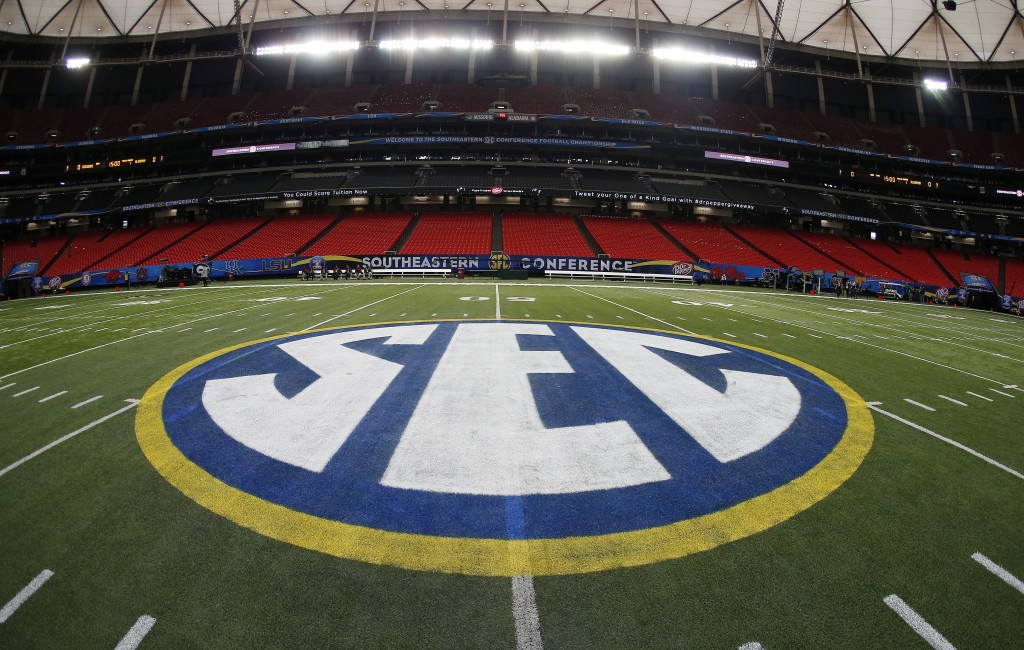 FILE - In this Dec. 5, 2014, file photo, the SEC logo is displayed on the field ahead of the Southeastern Conference championship football game betwee...