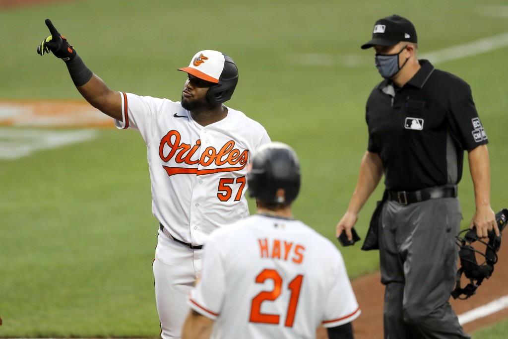 Baltimore Orioles' Hanser Alberto (57) gestures after hitting a two-run home run off New York Yankees starting pitcher J.A. Happ during the first inni...