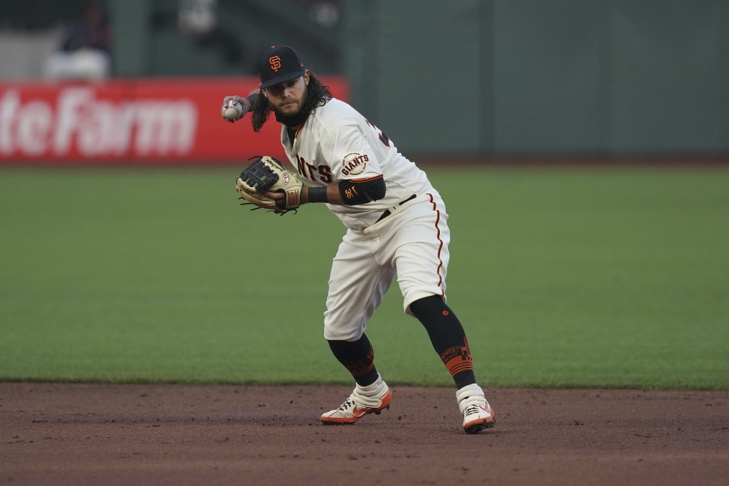 San Francisco Giants shortstop Brandon Crawford throws to first base on San Diego Padres' Francisco Mejia's ground out during the third inning of a ba...