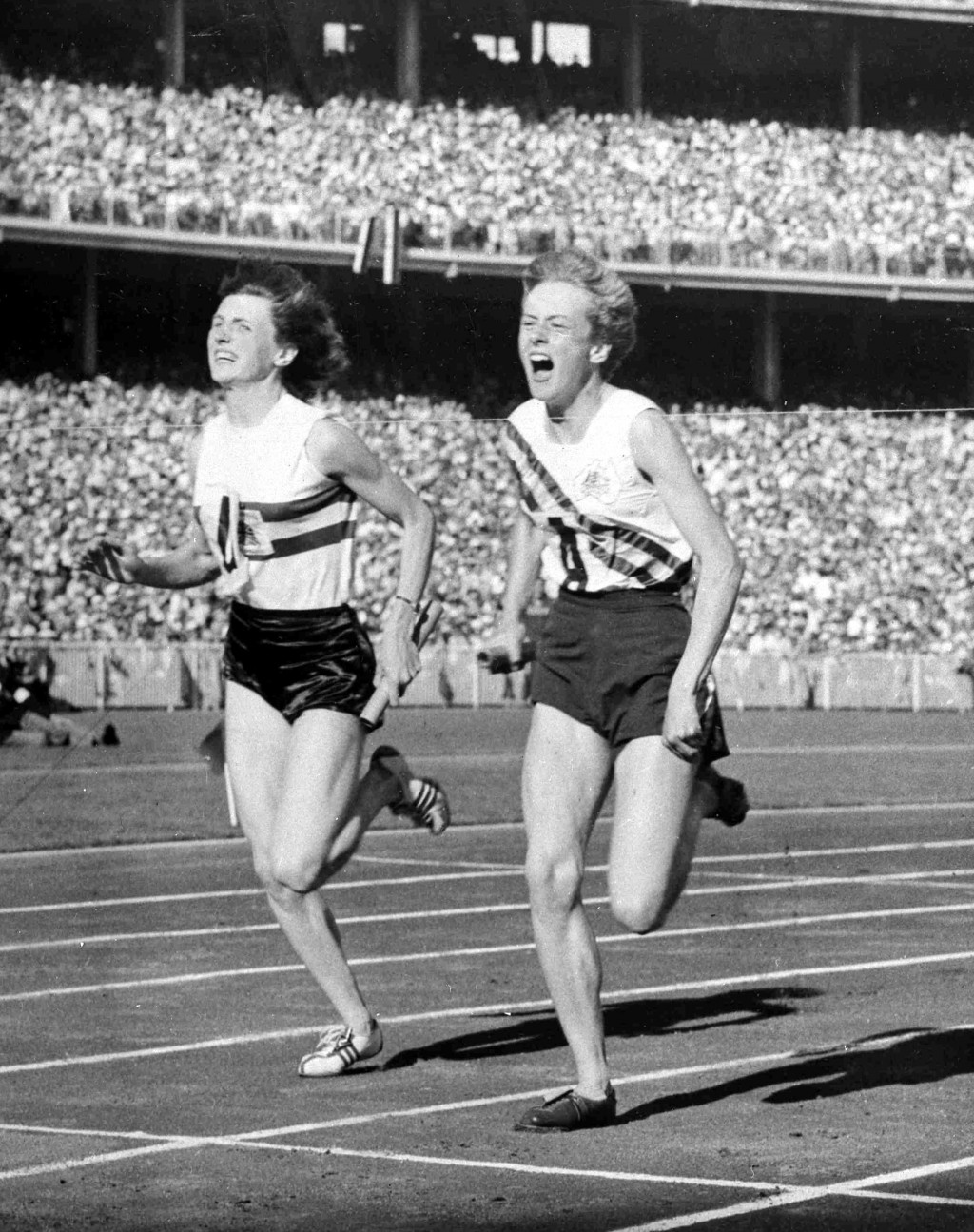 FILE - In this Dec. 1, 1956, file photo, Australia's Betty Cuthbert, right, wins the 4 x 100-meter relay final, in a new world Record time of 44.5 sec...
