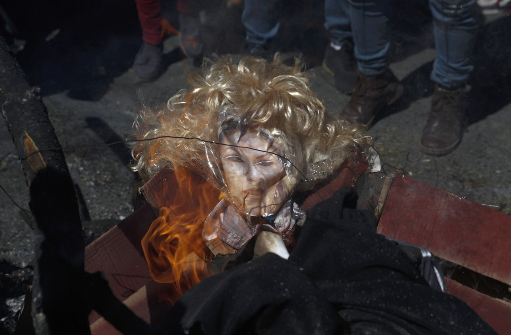 Demonstrators burn an effigy of Bolivia's interim President Jeanine Anez during a protest against the postponement of the upcoming presidential electi...