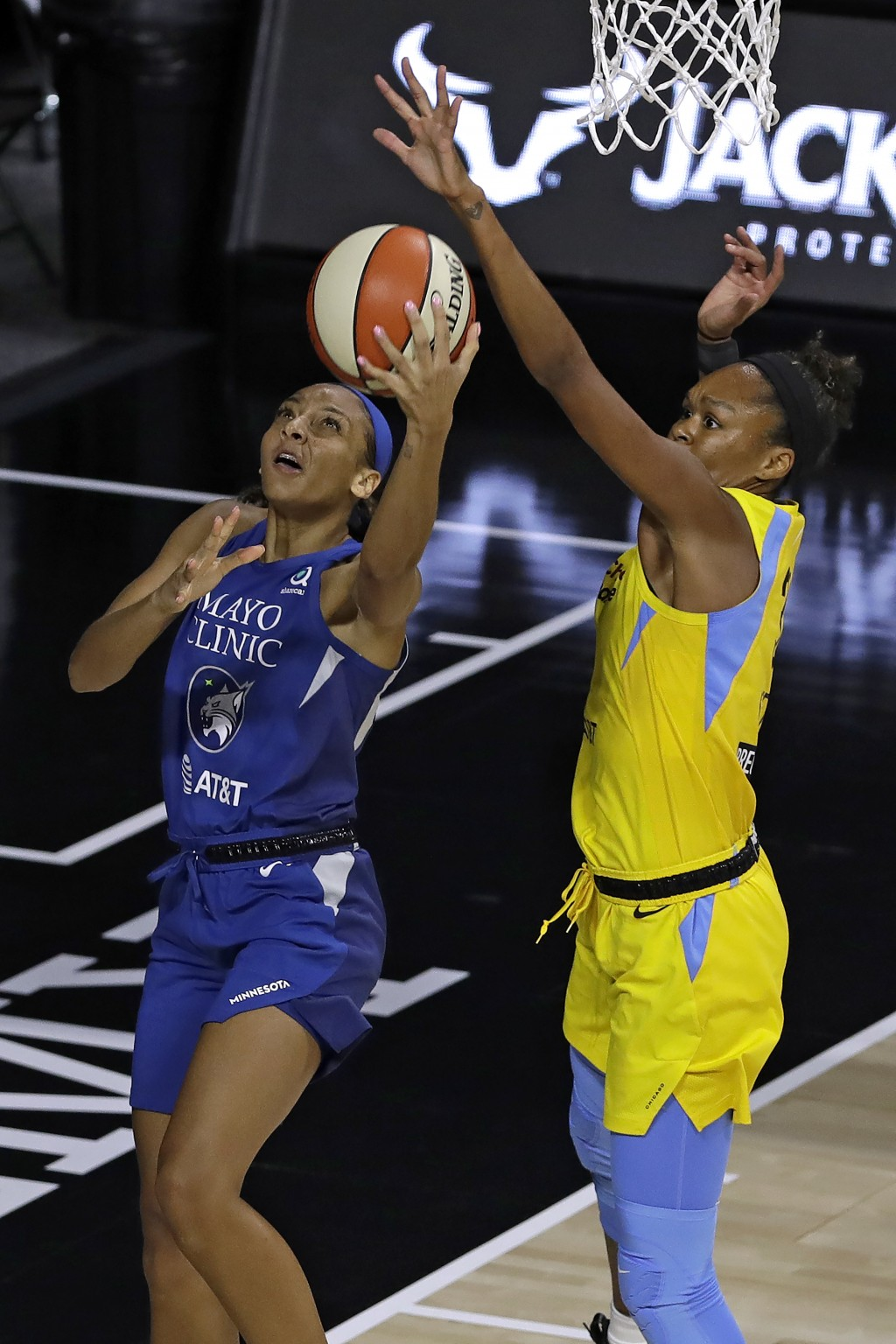 Minnesota Lynx forward Mikiah Herbert Harrigan (21) goes up in front of Chicago Sky forward Azura Stevens (30) during the first half of a WNBA basketb...