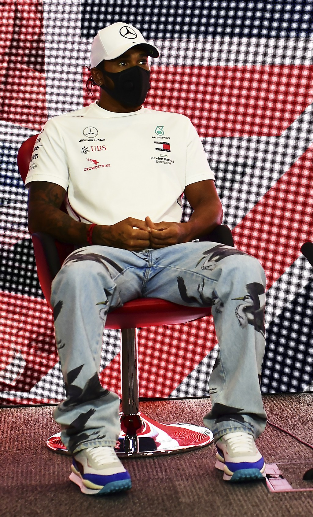 Lewis Hamilton of Great Britain and Mercedes GP talks in the Drivers Press Conference during previews ahead of the F1 Grand Prix of Great Britain at S...