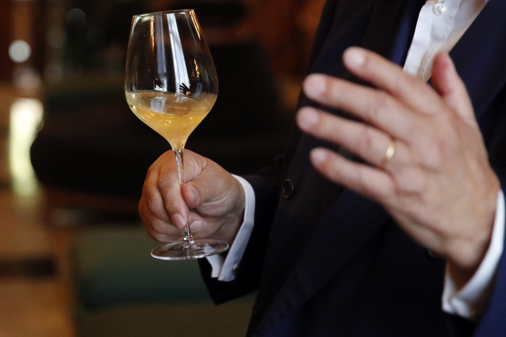 Paul Francois Vranken, Director of Vranken-Pommery Monopole holds a glass during an interview in the Champagne region, east of Paris, Tuesday, July 28...