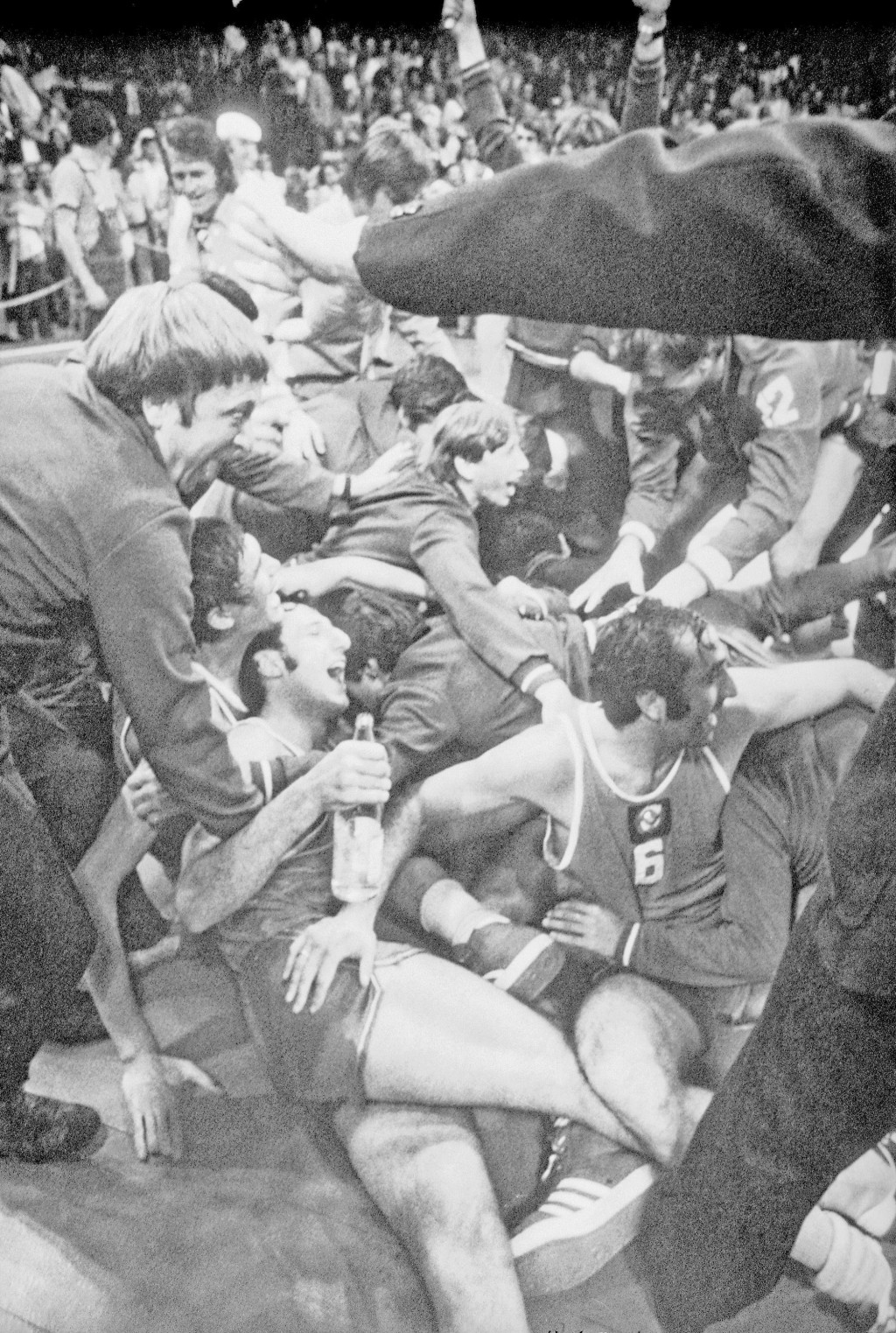 FILE - In this Sept. 10, 1972, file photo, Soviet players and supporters join in a joyous melee on the floor of the Munich Basketball Stadium, in Muni...