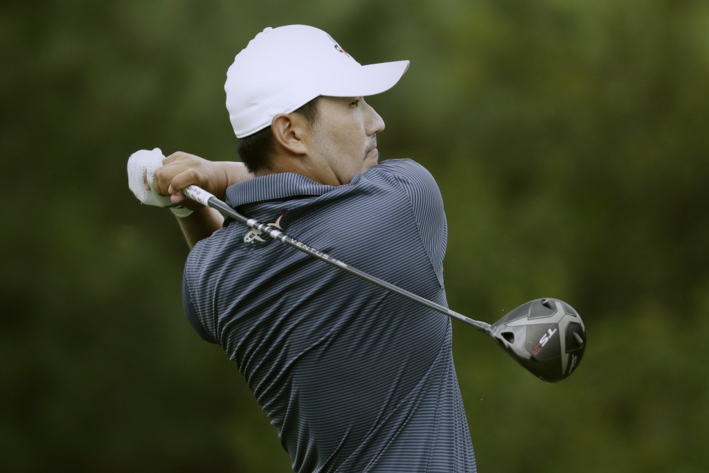 Sung Kang of South Korea, watches his tee shot on the 17th hole during the first round of the World Golf Championship-FedEx St. Jude Invitational Thur...