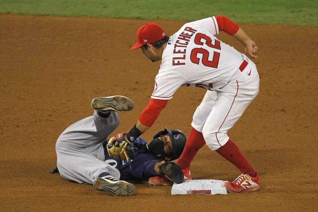 Seattle Mariners' Mallex Smith, left, is tagged out at second by Los Angeles Angels shortstop David Fletcher after being caught off base during the se...