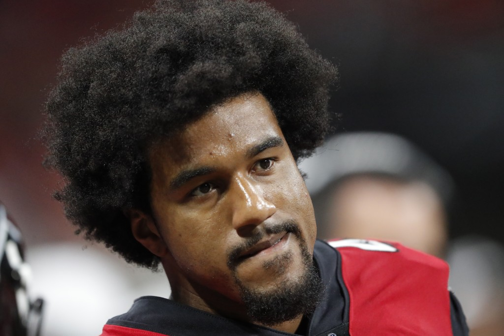FILE - In this Aug. 15, 2019, file photo, Atlanta Falcons linebacker Vic Beasley (44) sits on the bench during the first half an NFL preseason footbal...