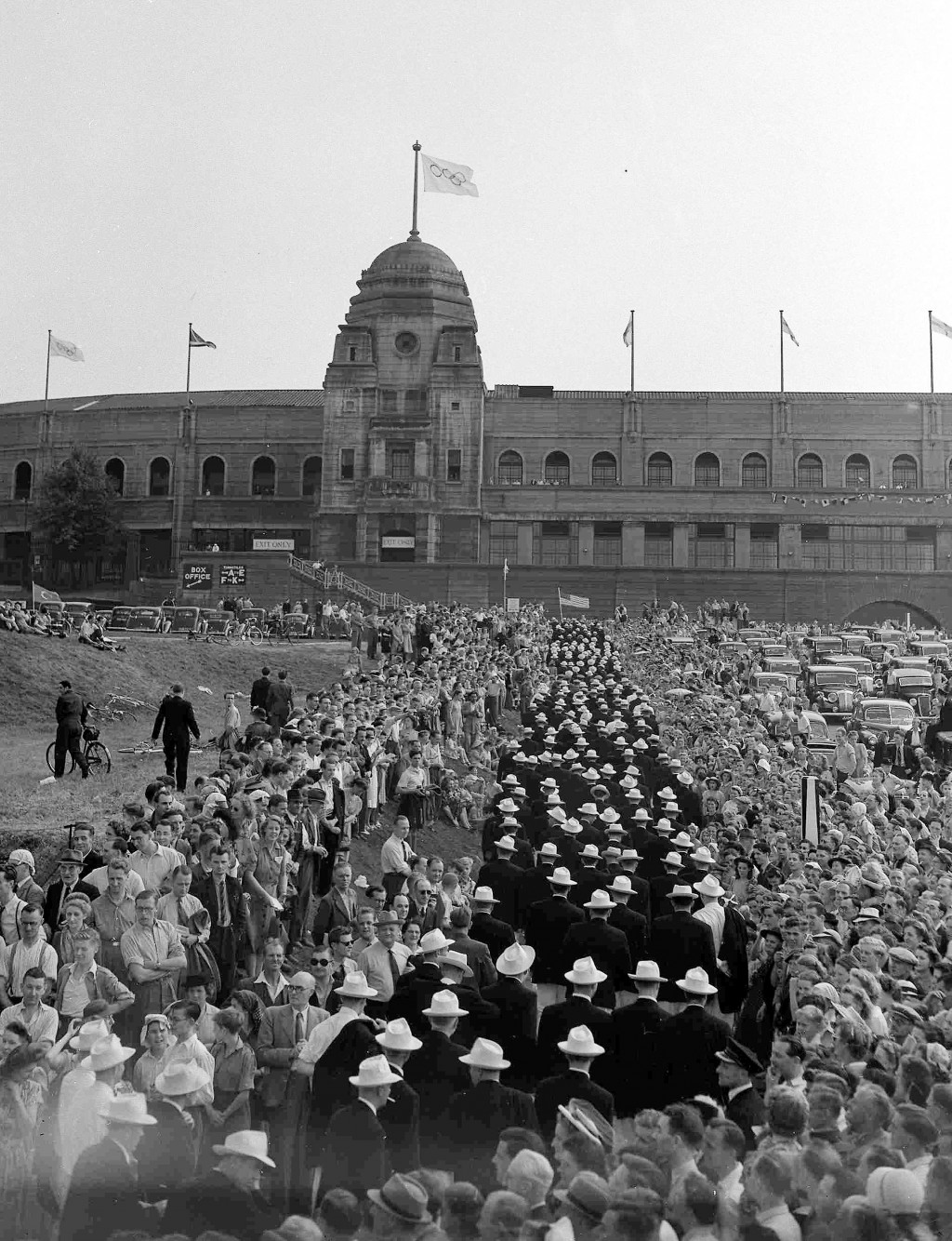 FILE - In this July 29, 1948 file photo,  American contingent pass through the crowd and prepare to enter Wembley Stadium, for the grand parade of all...