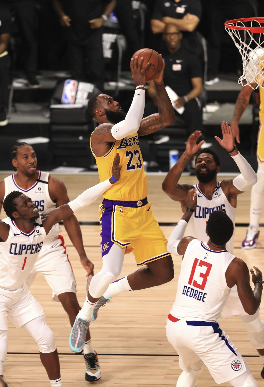 Los Angeles Lakers' LeBron James (23) makes a shot against the Los Angeles Clippers during the fourth quarter of an NBA basketball game Thursday, July...