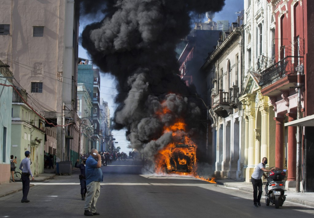 An empty parked bus burns on Belascoain Street in Havana, Cuba, Wednesday, July 29, 2020. Neither residents nor police at the scene knew how the blaze...