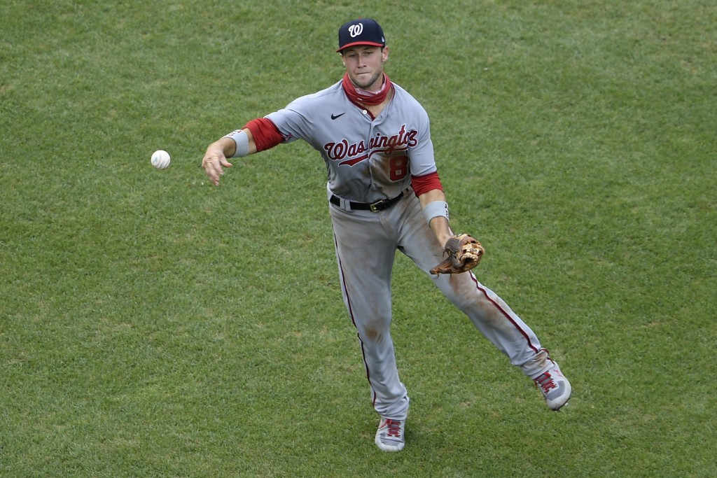 Washington Nationals third baseman Carter Kieboom throws to first for the out on Toronto Blue Jays' Brandon Drury during the fourth inning of a baseba...