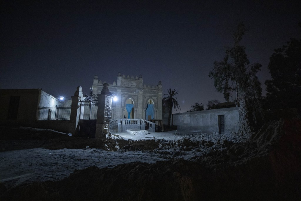 A tomb from the early 20th Century stands partially demolished amid construction of a new highway through the Northern Cemetery in Cairo, Egypt, Sunda...