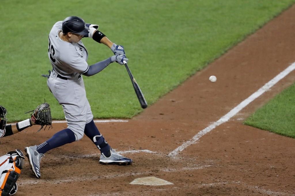New York Yankees' Aaron Judge connects for a three-run home run off Baltimore Orioles relief pitcher Cole Sulser during the ninth inning of a baseball...