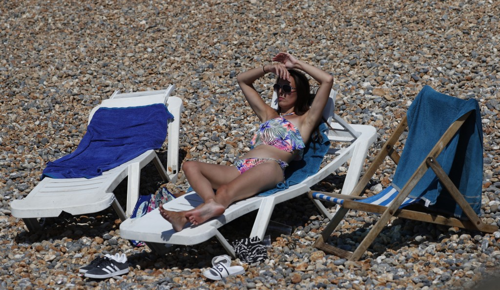 A Beachgoer enjoy the sunshine and sea on what is now Britain's hottest day of the year so far, in Brighton, England, Friday, July 31, 2020. Temperatu...