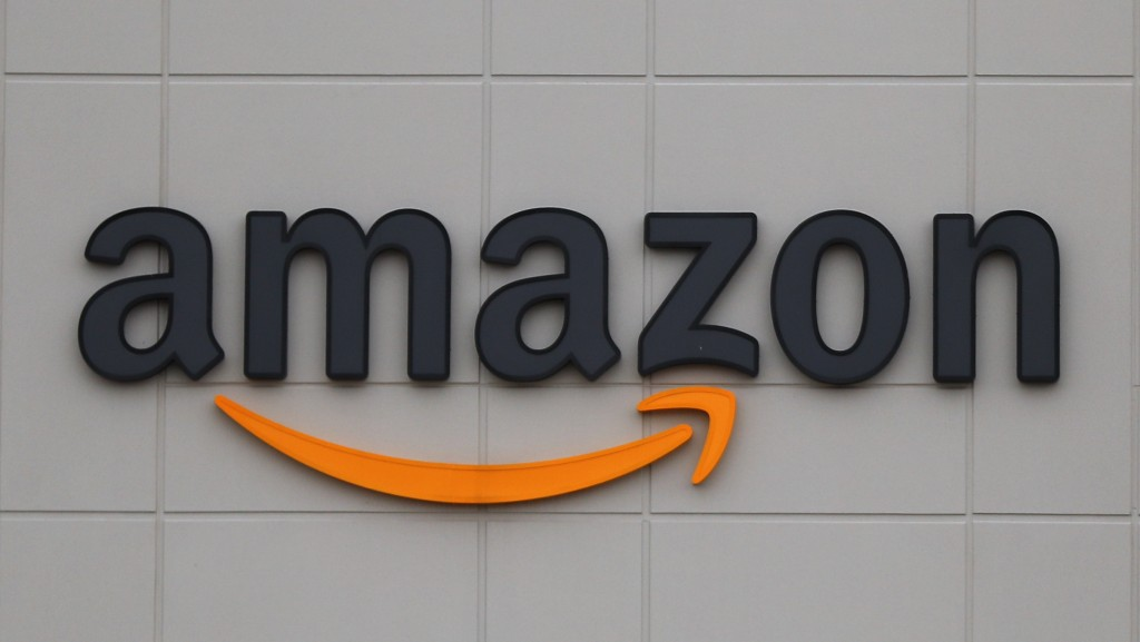 FILE - The Amazon DTW1 fulfillment center is shown in Romulus, Mich., April 1, 2020.  Big Tech companies reported mixed quarterly earnings on Thursday...