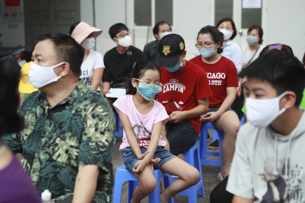 People wait in line to be tested for COVID-19 in Hanoi, Vietnam, Friday, July 31, 2020. Vietnam reported on Friday the country's first ever death of a...