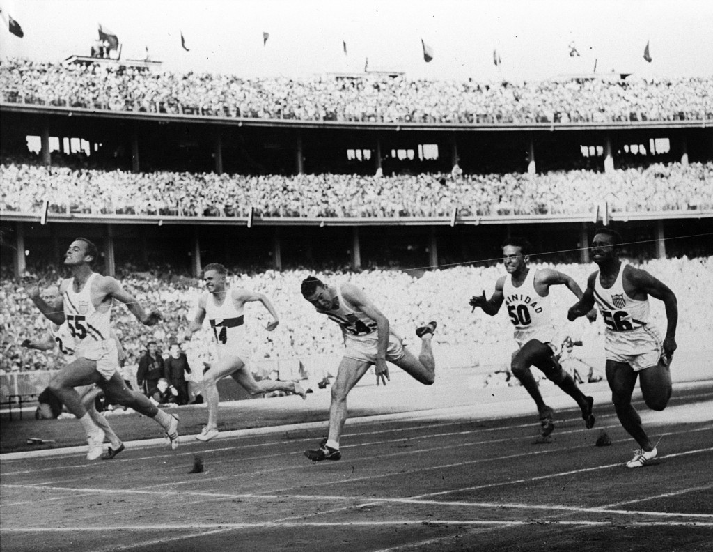 FILE - In this Nov. 23, 1956, file photo, United States' Bobby Joe Morrow (55) crosses the finish line of the men's 100-meter race in 10.5 seconds, eq...