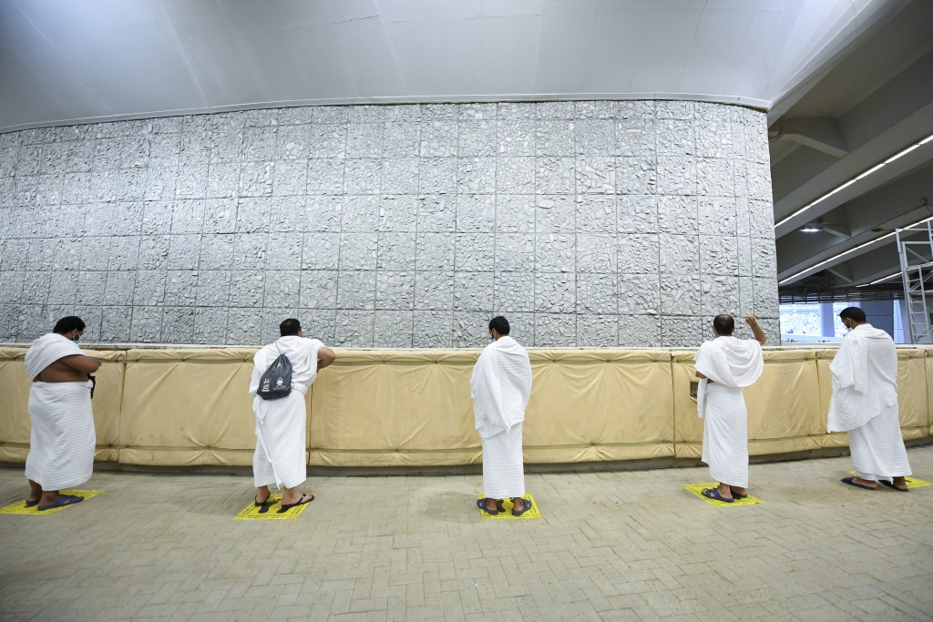 Muslim pilgrims cast stones at a pillar in the symbolic stoning of the devil, the last rite of the annual hajj, and the first day of Eid al-Adha, in M...
