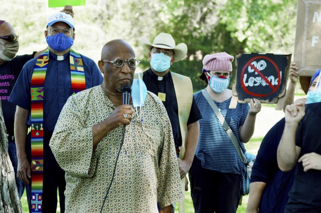 Jim Harvey of the Albuquerque Center for Peace and Justice speaks at a protest on Thursday, July 30, 2020, in Albuquerque, N.M., denouncing President ...