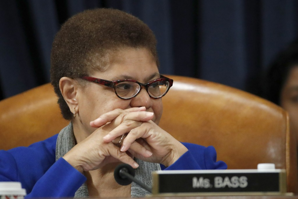 FILE - Dec. 12, 2019, file photo Rep. Karen Bass, D-Calif., listens during a House Judiciary Committee markup of the articles of impeachment against P...