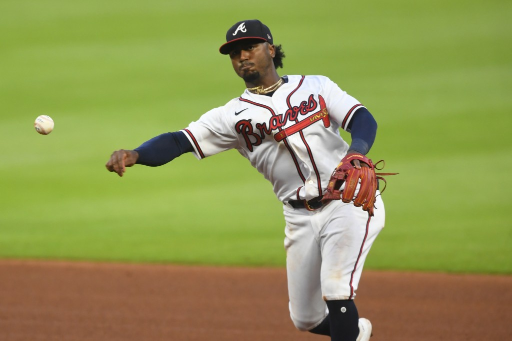Atlanta Braves second baseman Ozzie Albies Tampa Bay Rays' Joey Wendle at first base during the sixth inning of a baseball game Thursday, July 30, 202...