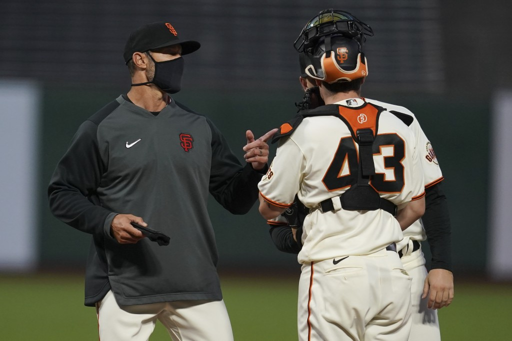 San Francisco Giants manager Gabe Kapler, left, talks with catcher Tyler Heineman (43) and pitcher Caleb Baragar during the fifth inning of a baseball...