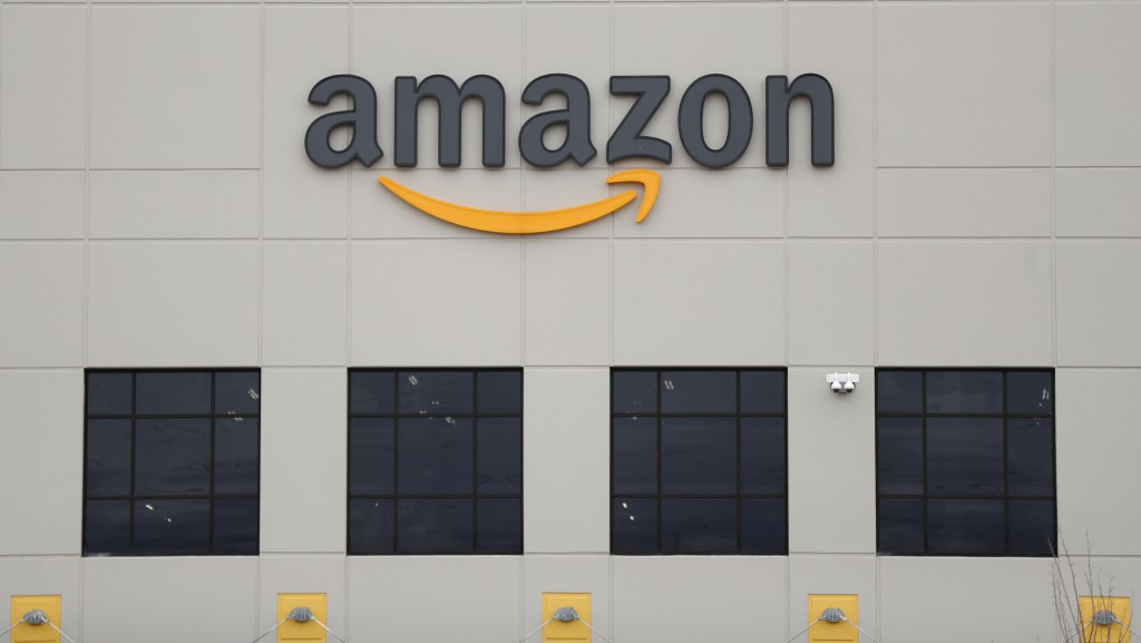 FILE - The Amazon DTW1 fulfillment center is shown in Romulus, Mich.  Amazon is heading to space. The online shopping giant received government approv...