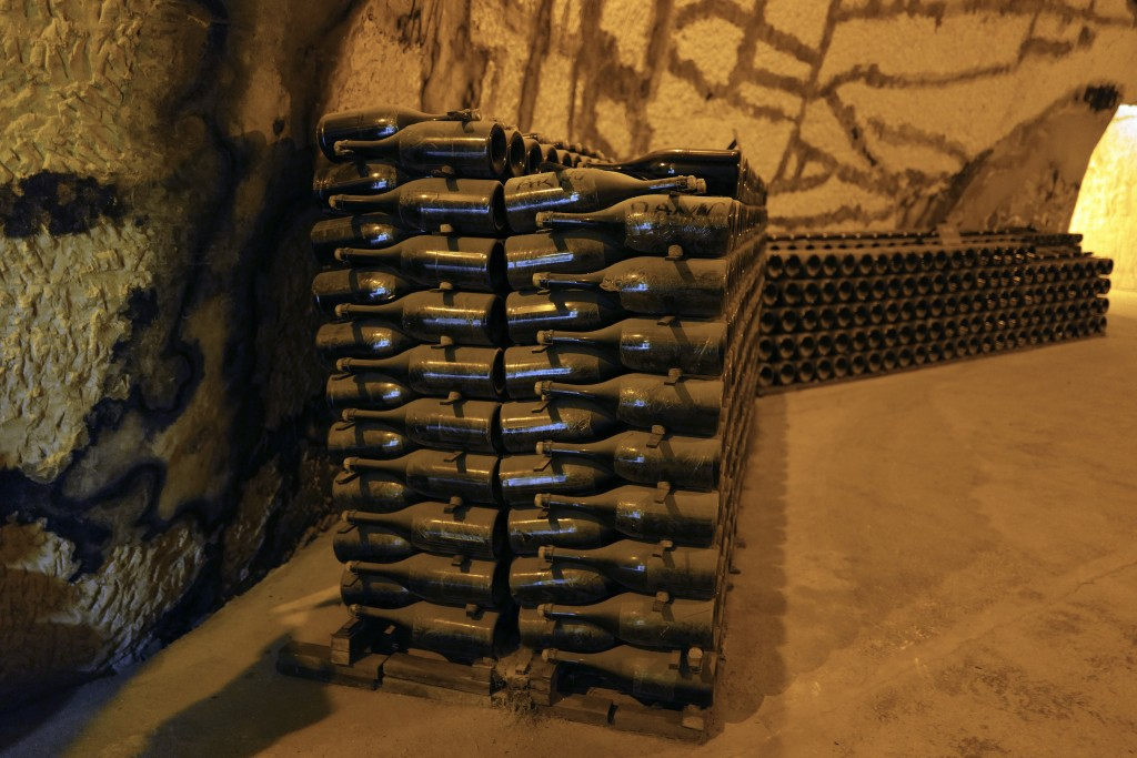 Champagne bottles piled in the cave of the Vranken-Pommery Monopole in Reims, the Champagne region, east of Paris, Tuesday, July 28, 2020. Producers i...