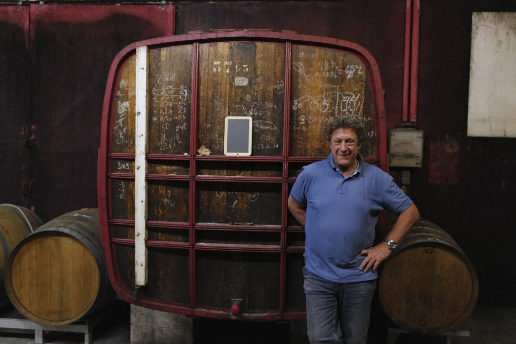 Champagne producer Anselme Selosse poses in front his 1974 first barrel in Avize, in the Champagne region, east of Paris, Tuesday, July 28, 2020. Prod...