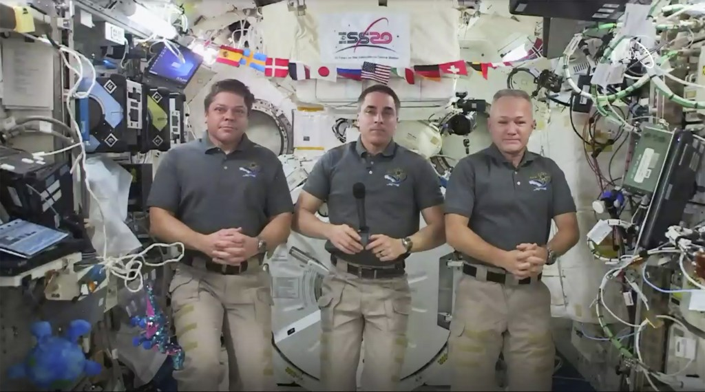 This photo provided by NASA shows from left, astronauts Bob Behnken, Chris Cassidy and Doug Hurley during an interview on the International Space Stat...