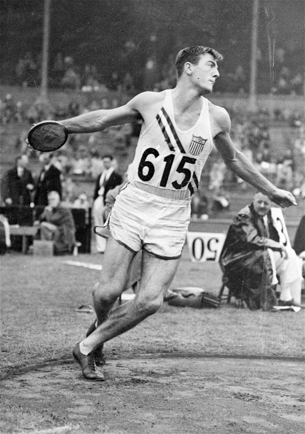 FILE - In this Aug. 6, 1948, file photo, Bob Mathias, of the United States, throws the discus during the decathlon competition at Wembley Stadium at t...
