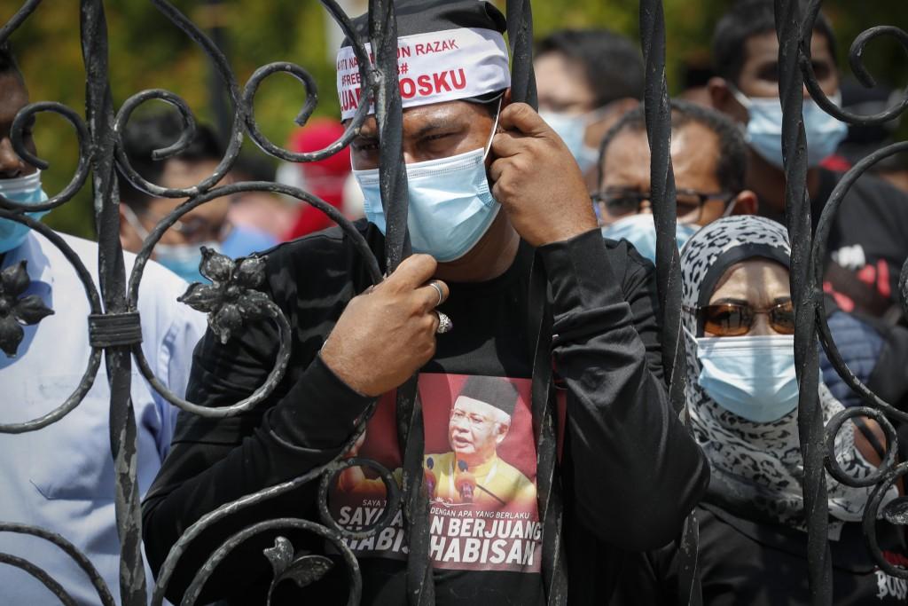 Supporters of former Malaysian Prime Minister Najib Razak, react outside a court house in Kuala Lumpur, Malaysia, Tuesday, July 28, 2020. A Malaysian ...