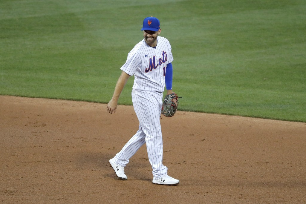 New York Mets second baseman Brian Dozier smiles during the second inning of the baseball game against the Boston Red Sox at Citi Field, Thursday, Jul...