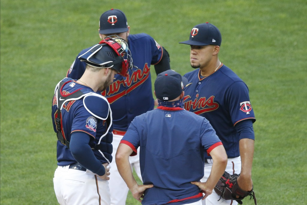 Minnesota Twins pitcher Jose Berrios, right, gets a mound visit from pitching coach Wes Johnson after giving up a two-run home run to Cleveland Indian...