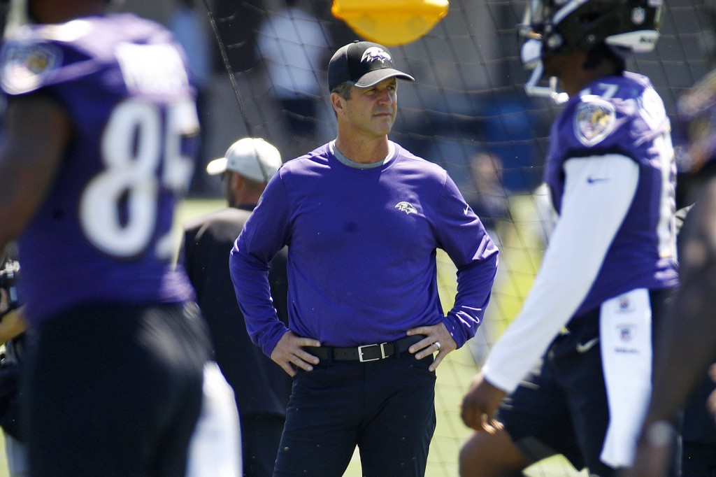 FILE - In this July 19, 2018, file photo, Baltimore Ravens head coach John Harbaugh watches an NFL football training camp practice at the team's headq...
