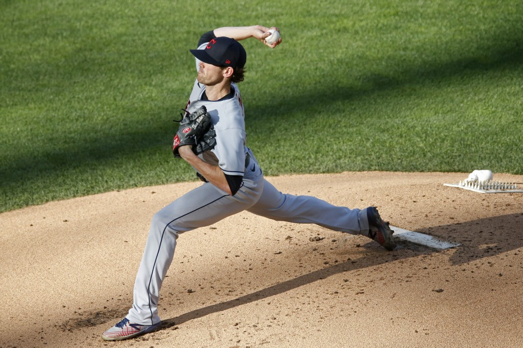 Cleveland Indians' pitcher Shane Bieber throws against the Minnesota Twins in the first inning of a baseball game Thursday, July 30, 2020, in Minneapo...