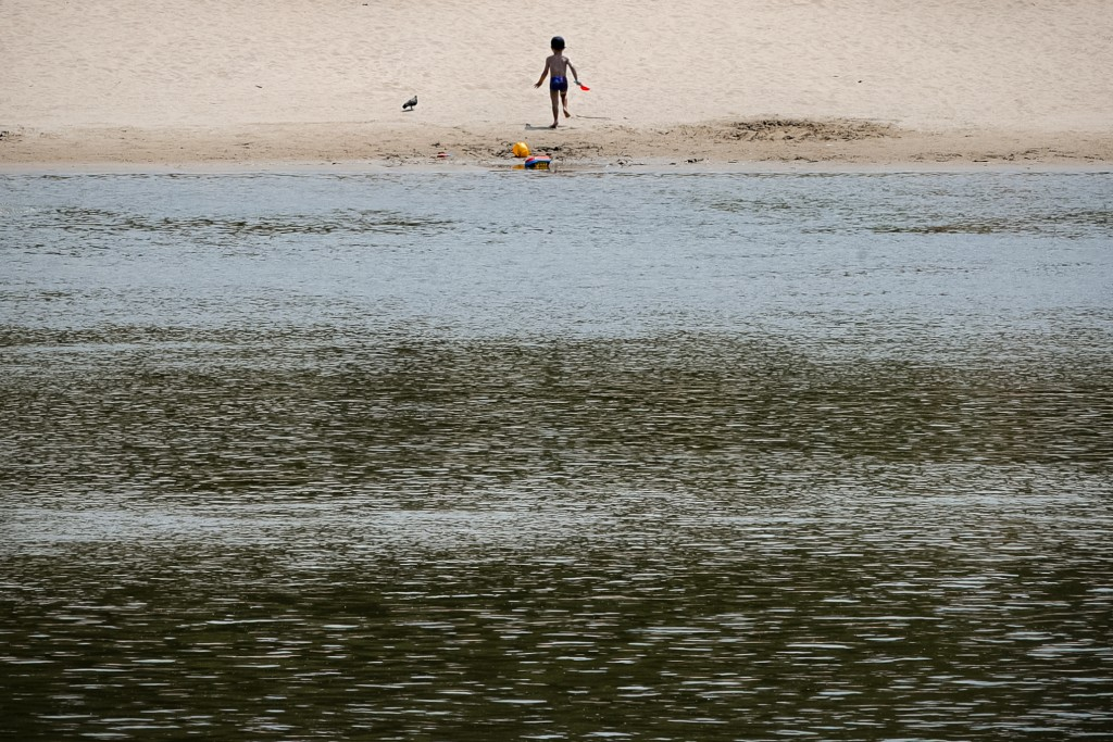 A child runs on a beach along the banks of the river Danube in Calarasi, southern Romania, Monday, July 27, 2020. Romania is registering more than 1,0...