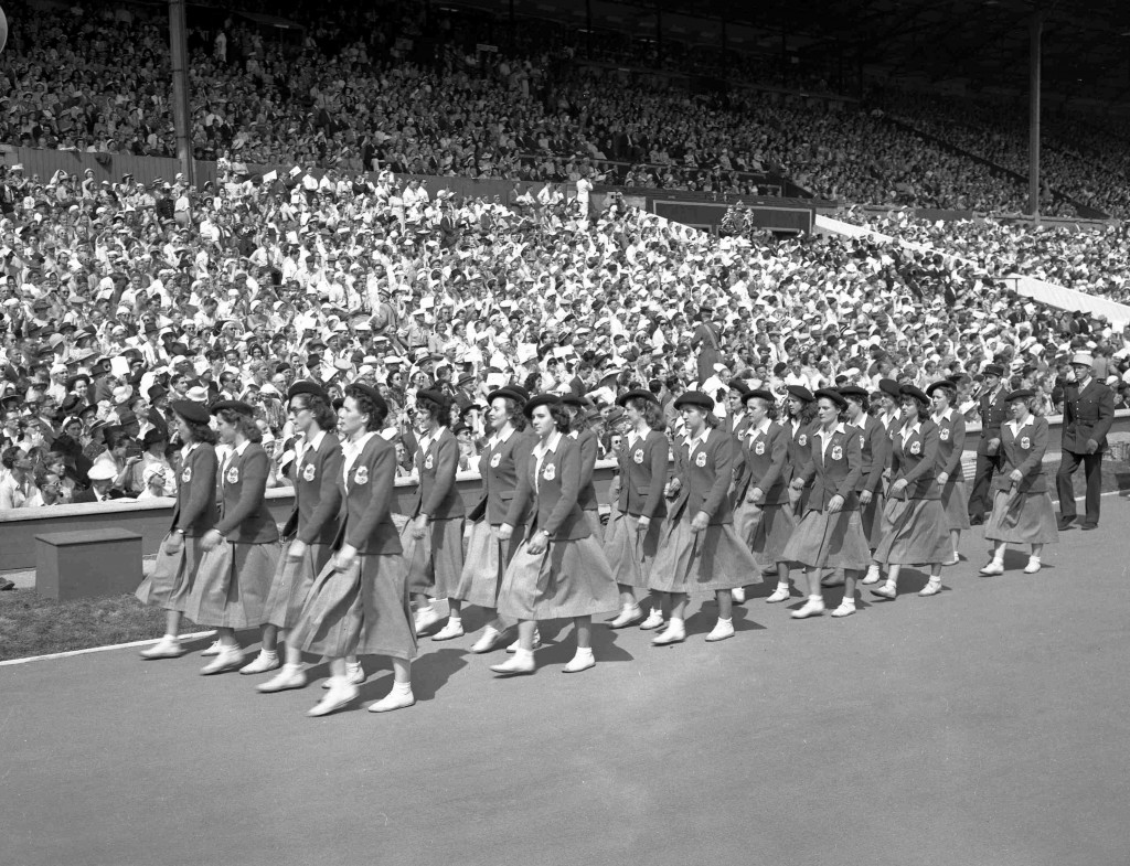 FILE - In this July 29, 1948 file photo, French women athletes march past the Royal Box in Wembley Stadium, London, during the opening ceremony of the...