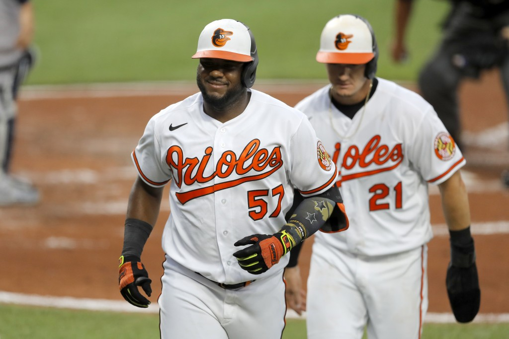 Baltimore Orioles' Hanser Alberto (57) reacts after hitting a two-run home run off New York Yankees starting pitcher J.A. Happ during the first inning...