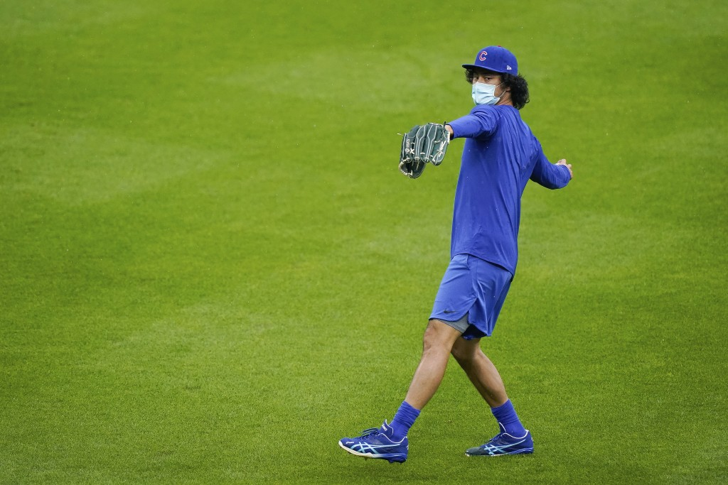 Chicago Cubs starting pitcher Yu Darvish (11), Thursday's scheduled starter, warms up prior to a baseball game against the Cincinnati Reds at Great Am...