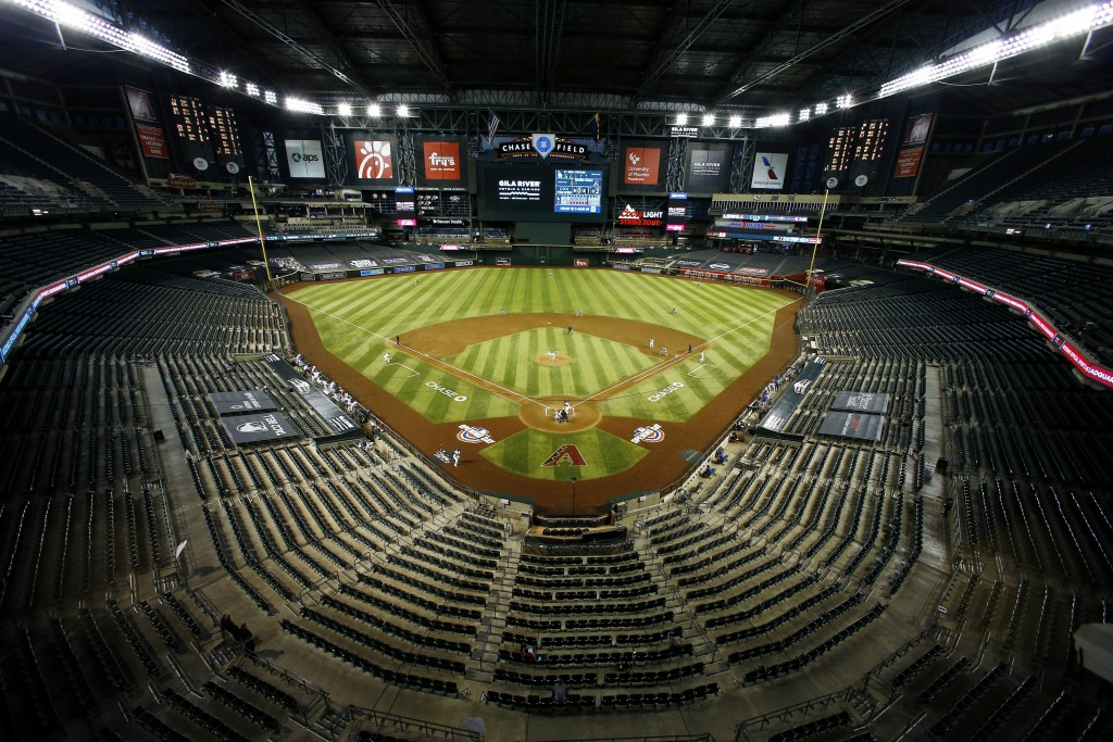 The Arizona Diamondbacks and the Los Angeles Dodgers play in an empty Chase Field during the fourth inning of the Diamondbacks' home opener baseball g...