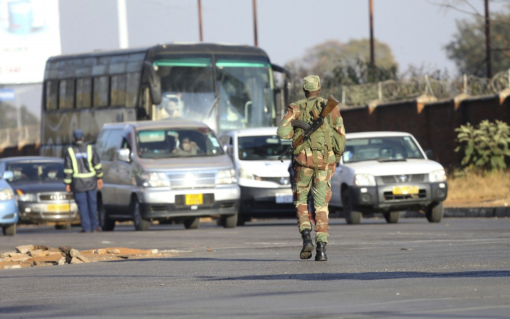 An armed soldier is seen on a street in Harare, Friday, July, 31, 2020. Zimbabwe's capital, Harare, was deserted Friday, as security agents vigorously...