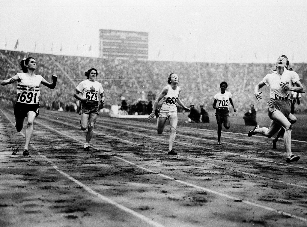 FILE - In this Aug. 2, 1948 file photo, Fanny Blankers-Koen, right, of Holland crosses the finish line in 11.9 seconds to win the Women's 100-meter Da...
