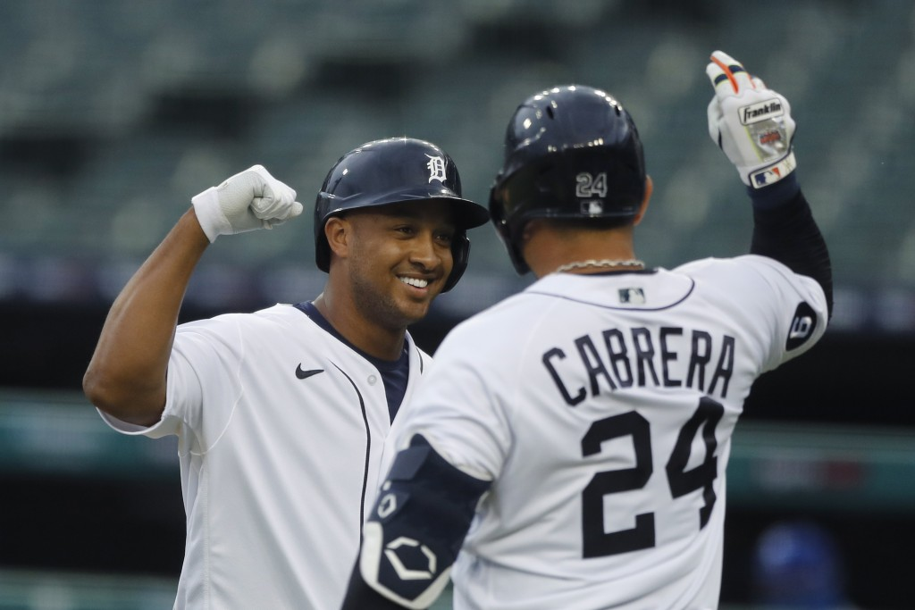 Detroit Tigers' Jonathan Schoop is greeted by teammate Miguel Cabrera after a solo home run to left field during the fourth inning of a baseball game ...