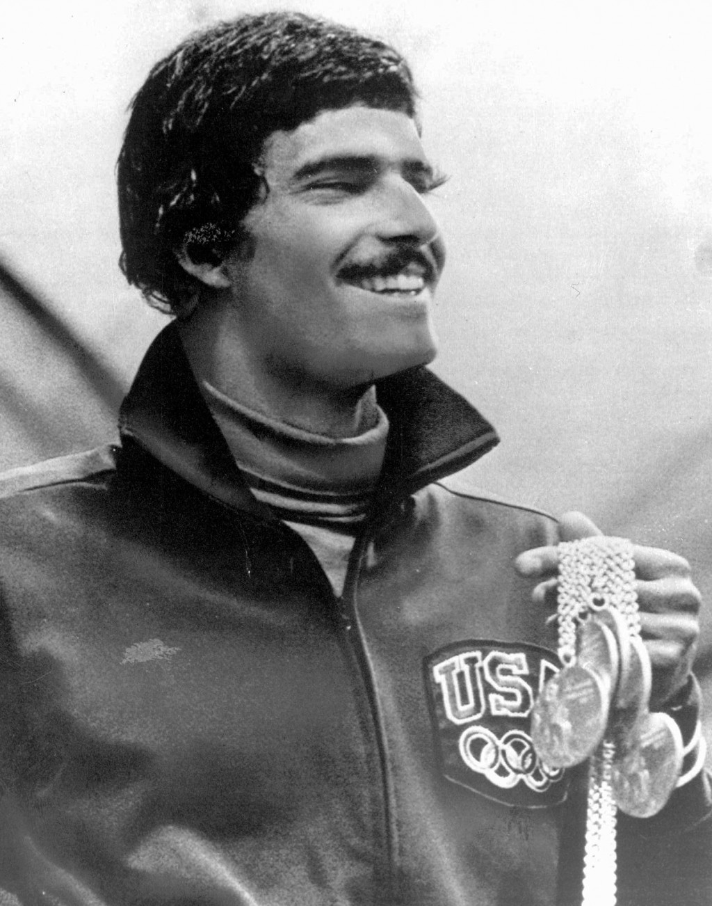 FILE - In this Aug. 31, 1972, file photo, American swimmer Mark Spitz holds five of the seven gold medals he won at the Olympics in Munich, Germany. (...