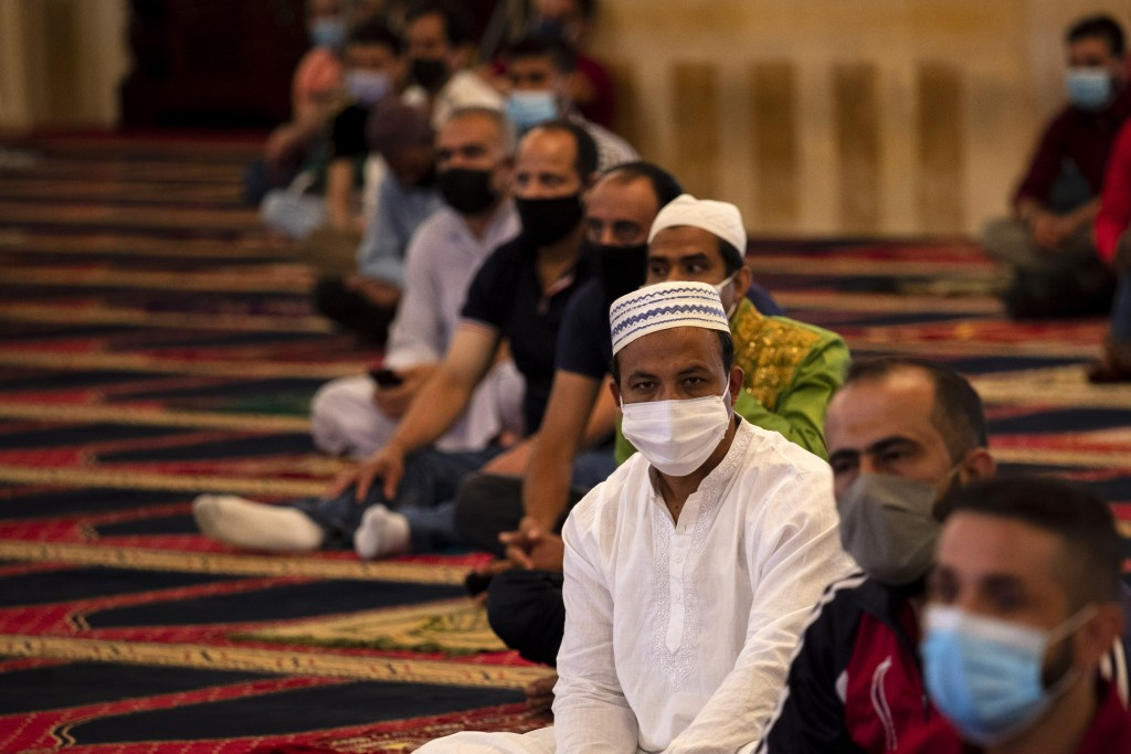 Muslim worshippers wearing masks to help stop the spread of the coronavirus, attend to offer Eid al-Adha prayer while maintaining a social distance at...